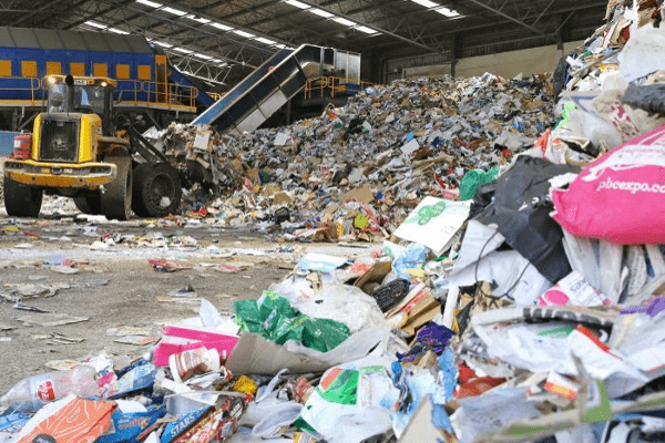 a-tractor-separates-material-for-recycling-at-re-groups-hume-facility